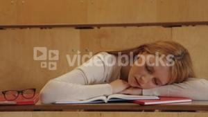 Student asleep sitting in class