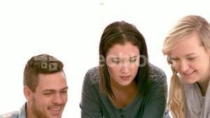 Creative business team looking at notes