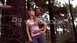 Couple hiking through a forest