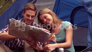 Couple looking at map in their tent