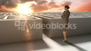 Businesswoman at entrance of maze