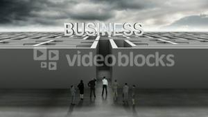 Business people at entrance of maze