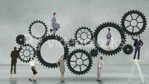 Business people running and turning cogs