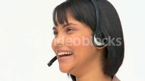 Asian woman speaking into the headset