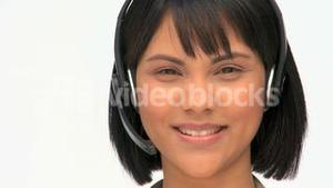 Asian business woman speaking into a headset