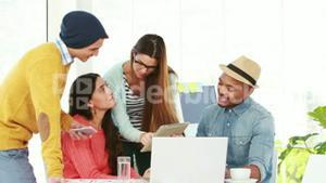 Creative hipster team working together in an office