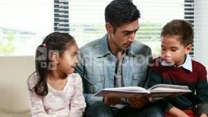 Father reading his kids a story