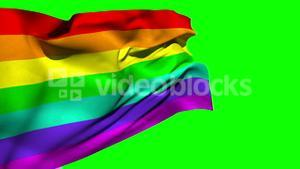 Rainbow flag blowing against green screen