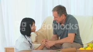 Asian nurse talking with her patient