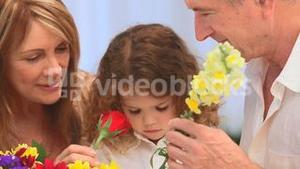 Cute girl making a bunch of flowers