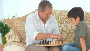 Little boy learning to play chess