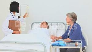 A sick man with his wife