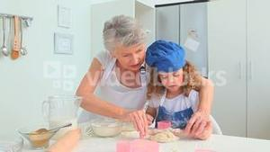 Adorable child learning to cook