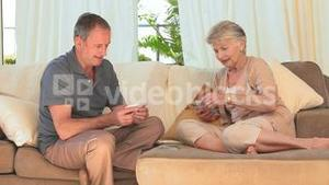 Lovely couple playing cards