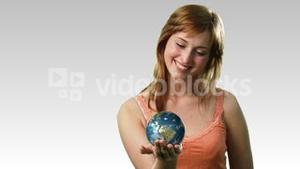 Attractive lady holding the earth