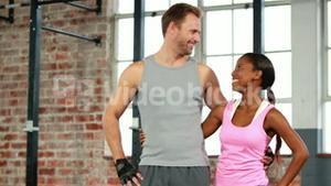 Fit couple in crossfit gym