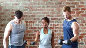 Fit class lifting dumbbells together
