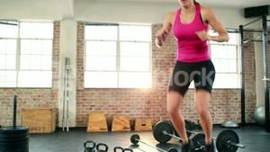 Fit woman doing box jumps