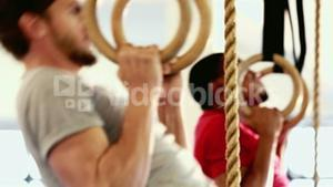 Fit people doing pull ups