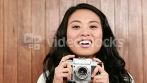 Asian hipster taking a photo