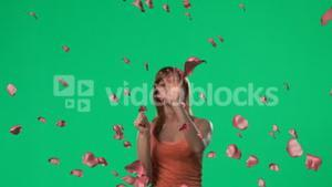 Woman catching falling roses