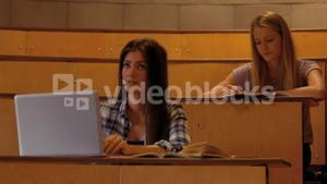 Students taking down notes in class