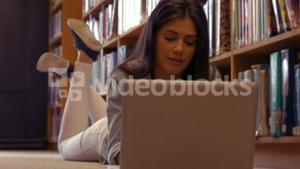 Quiet student using laptop in library