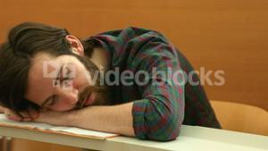 Student asleep with head on his desk