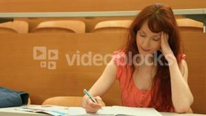Focused student taking down notes