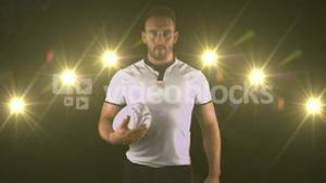 Serious rugby player brings rugby ball