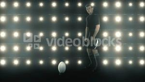Rugby player kicking rugby ball