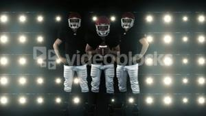 American football players standing face to the camera