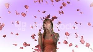 Woman catching falling roses in HD