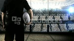 Rugby player standing face the post