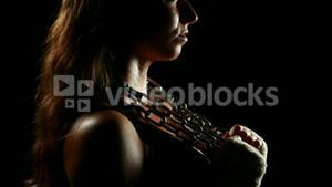 Muscular woman wearing bandage and holding chain
