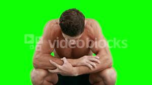 Disappointed muscular man looking down