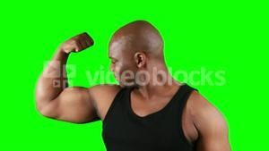 Muscular man with meat flexing muscles