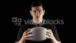 Serious rugby player with ball