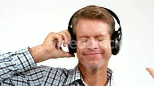 Casual man enjoying his music