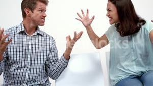 Angry couple arguing and shouting
