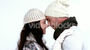 Winter couple hugging and smiling