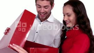 Happy couple opening gift together