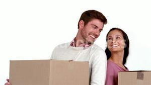 Cute couple with moving boxes