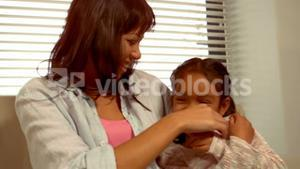 Smiling Hispanic mother with her daughter