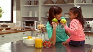 Smiling Hispanic mother discussing with her daughter
