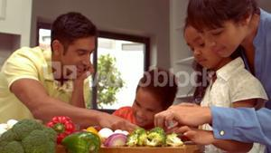 Smiling Hispanic family are cooking together