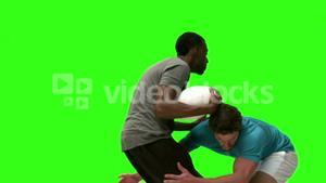 Rugby players tackling in slow motion