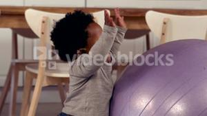 Cute baby playing with exercise ball