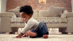 Baby boy playing with mobile phone