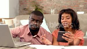Couple using computer together